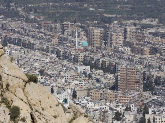 Syria population transfer begins with exchange of prisoners