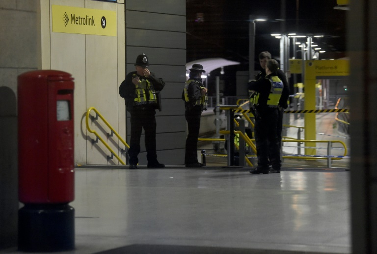 Two people and police officer stabbed at Manchester train station