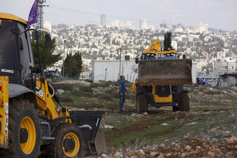 Israel announces new settlements, risking Biden's anger