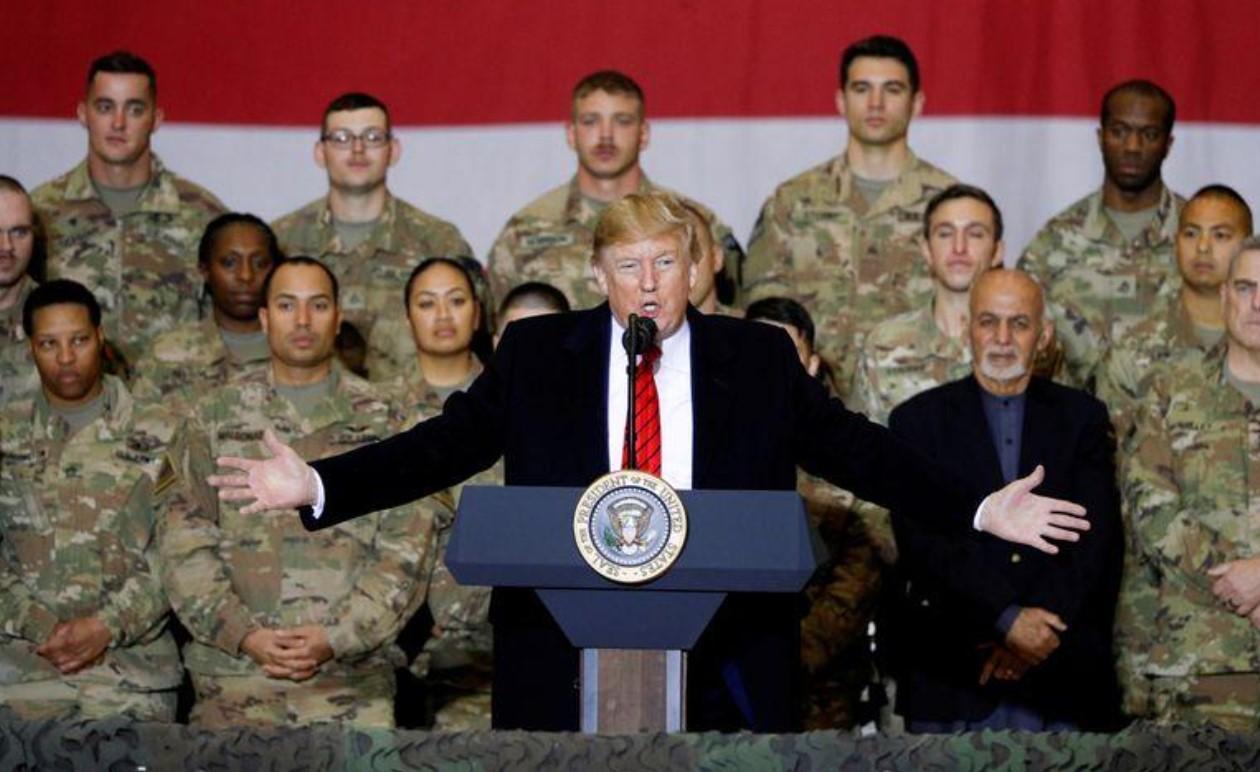 Exclusive: Pentagon presses ahead with Afghanistan troop drawdown despite law barring it