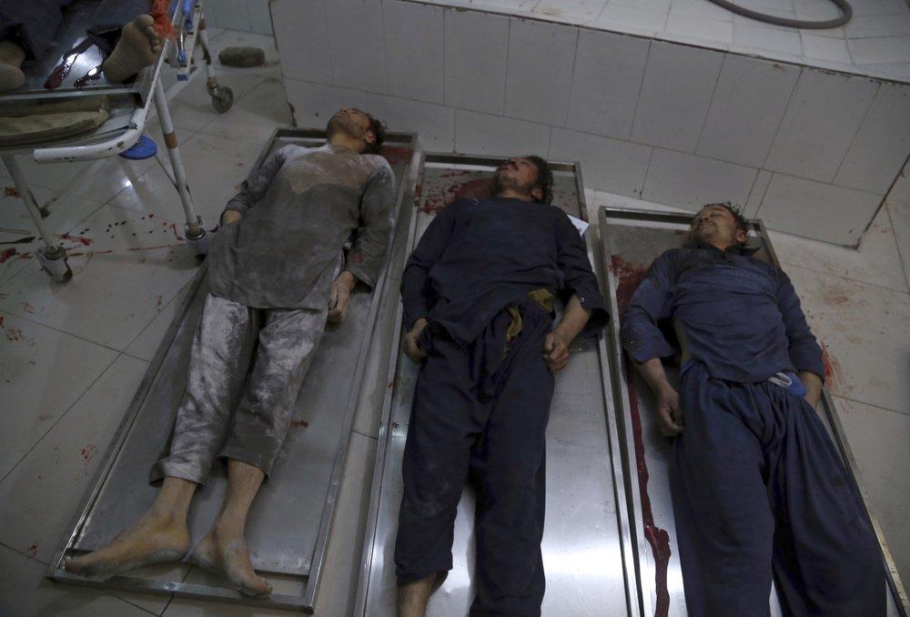 Afghan official: Gunmen kill 7 workers, bomb kills doctor