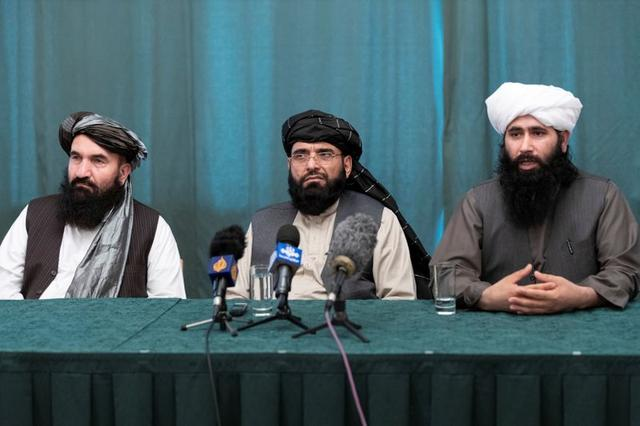 Members of the Taliban delegation: former western Herat Governor Khairullah Khairkhwa, member of the negotiation team Suhail Shaheen and spokesman for the Taliban's political office Mohammad Naeem attend a joint news conference in Moscow, Russia March 19, 2021. Alexander Zemlianichenko/Pool via REUTERS