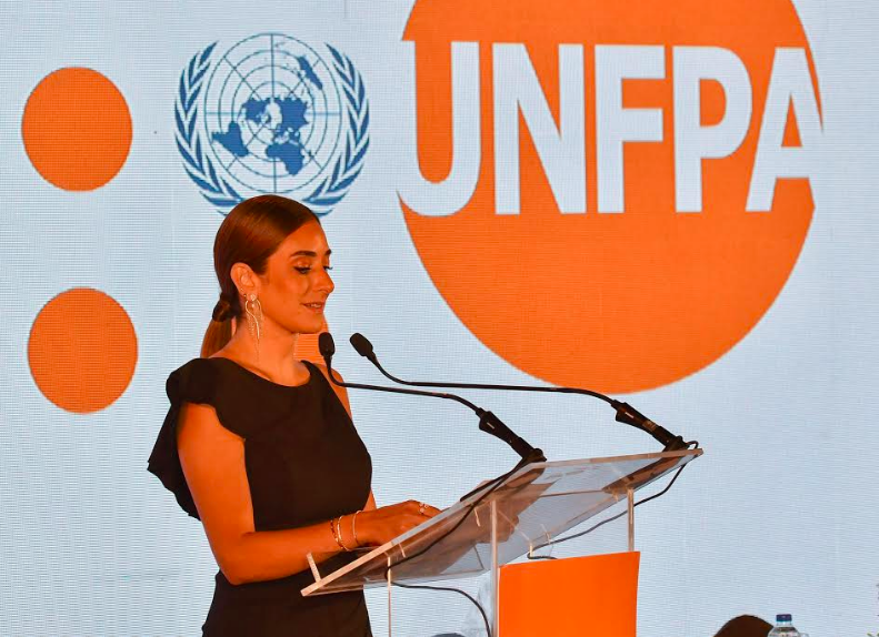 Actress Amina Khalil is giving a speech during a reception held to honor her as UNFPA ambassador.